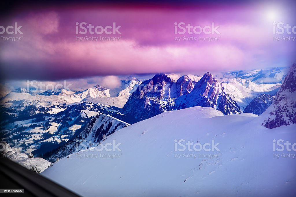 Winter mountains Switzerland in sunshine. Mountainside and deep snow. stock photo