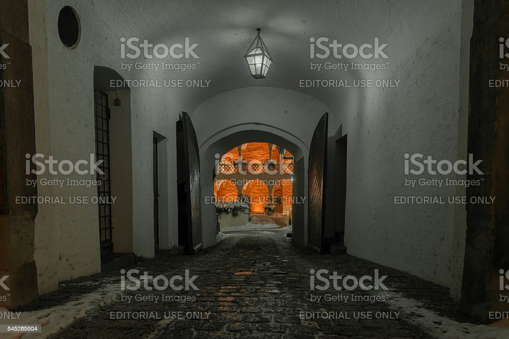 Winter night in Regensburg – illuminated narrow lane stock photo
