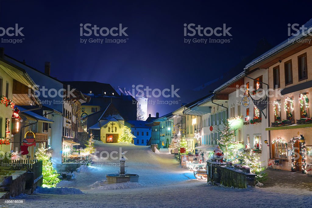 Winter night in the medieval town of Gruyeres stock photo