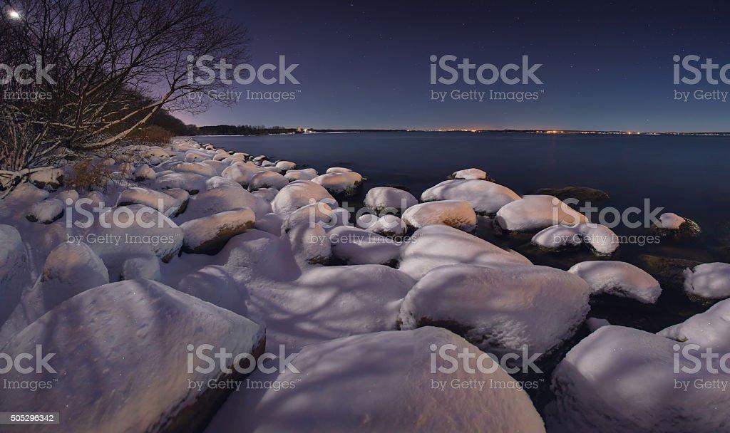 Winter night on the ocean stock photo