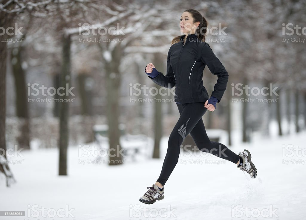 Winter Outdoor Fitness, Beautiful Woman jogging royalty-free stock photo