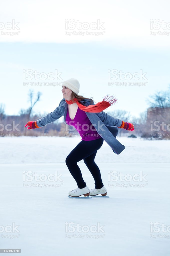 Winter Outdoor Teenage Girl Ice Skater in Red Scarf, Gloves stock photo