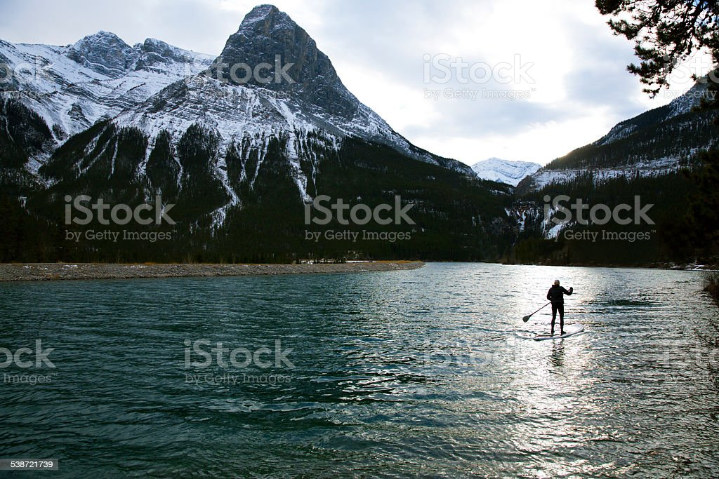 Winter Paddleboard Girl stock photo
