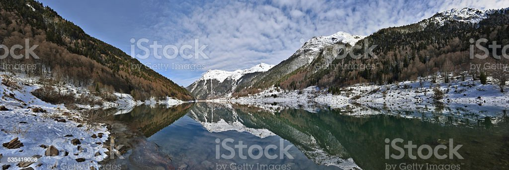 Winter Panorama Fabreges lake in Ossau Valley in French Pyrenees stock photo