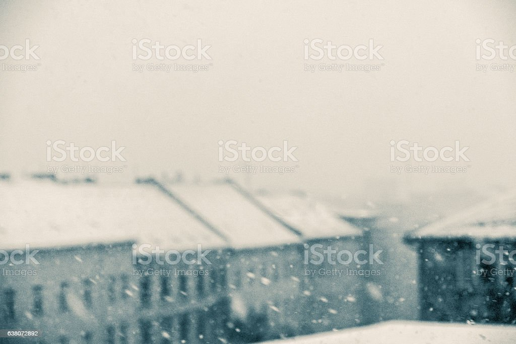 winter panorama, snowing on city skyline stock photo