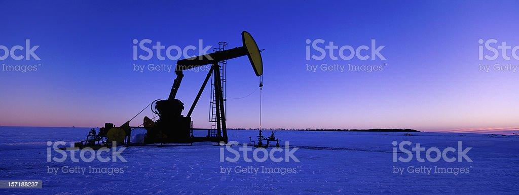 Winter Panoramic Oil Pumpjack banner stock photo