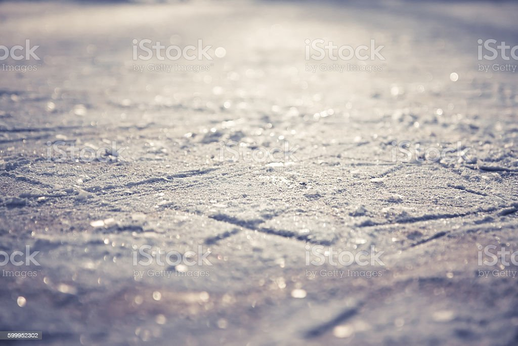 Winter pattern from snowflakes on shining ice skating rink stock photo