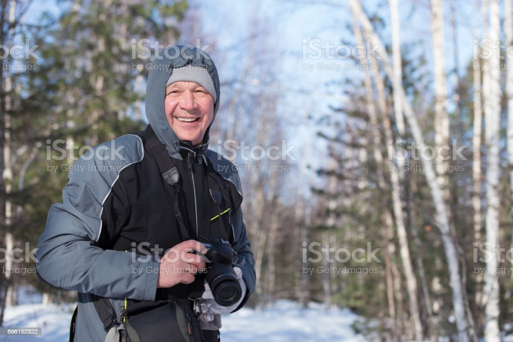 Winter photographer in snow forest. stock photo