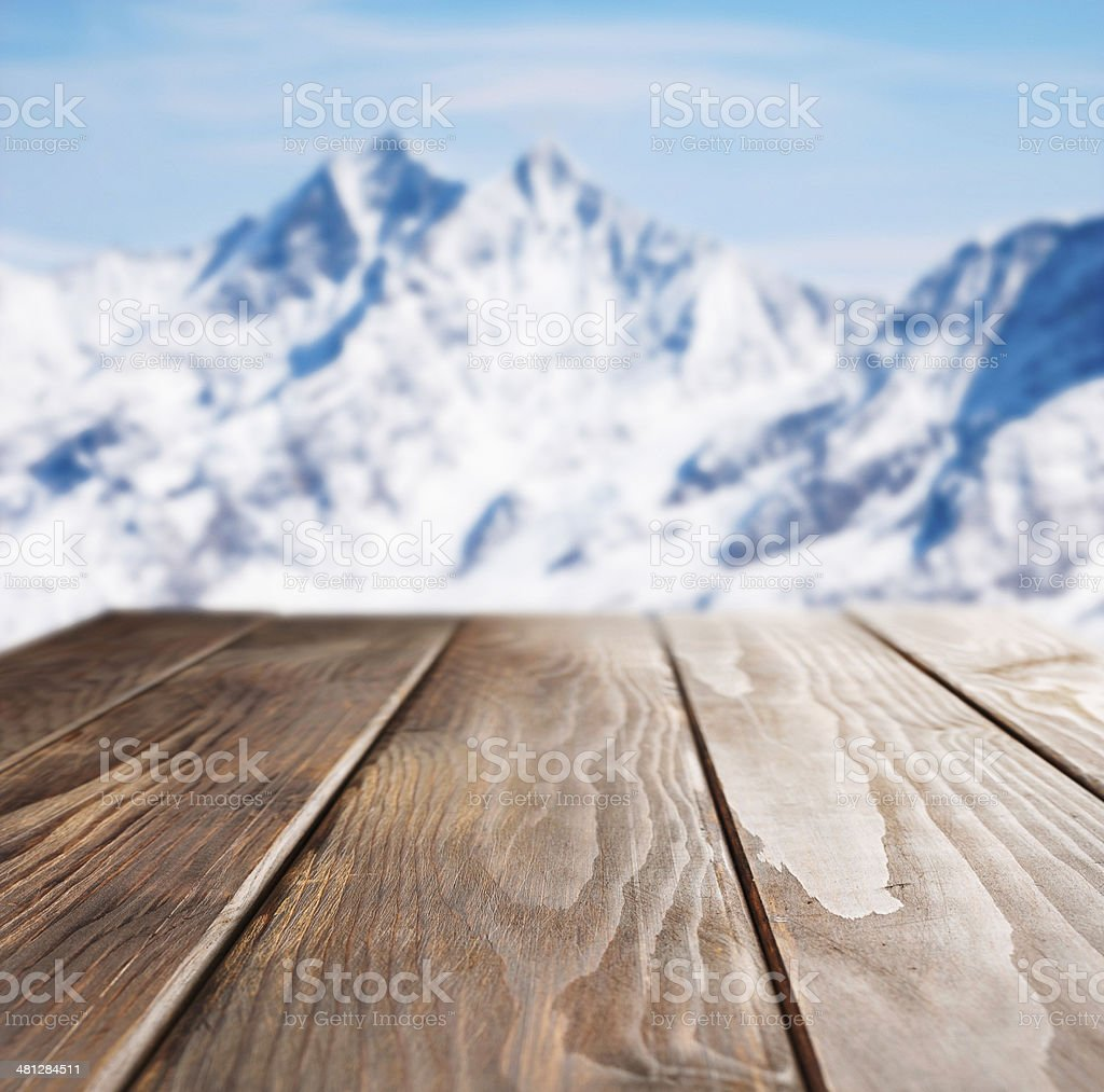 Winter picnic table  Pine wood  On top of snowy mountains stock photo