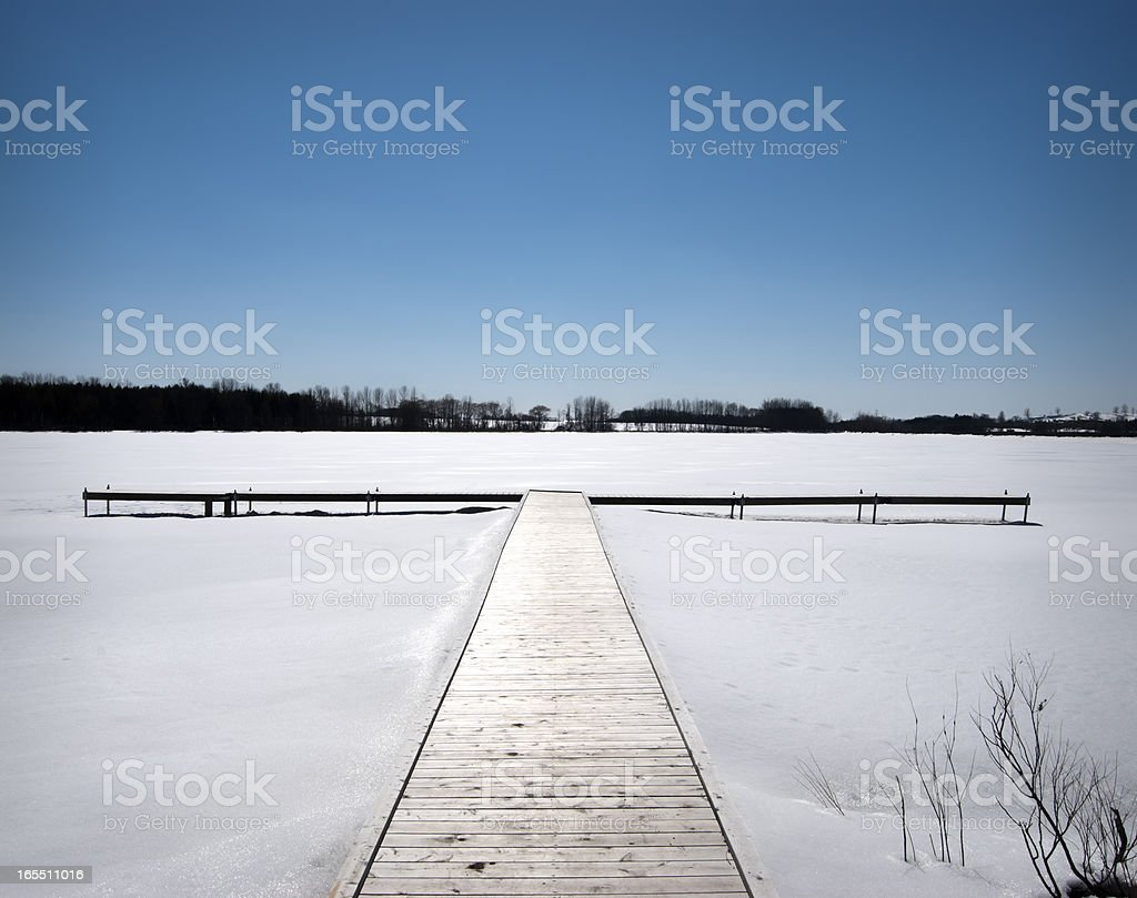 Winter Pier, Forested Lake stock photo