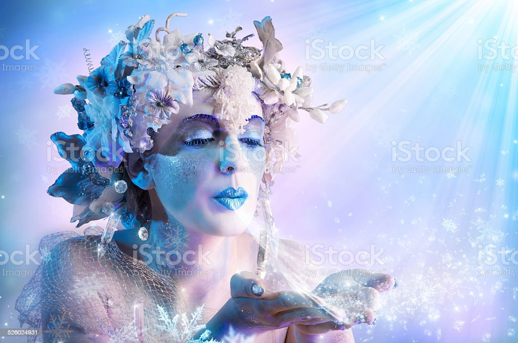Winter portrait  blowing snowflakes stock photo