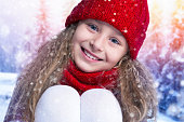 Winter. Portrait of a happy child. Beautiful little girl