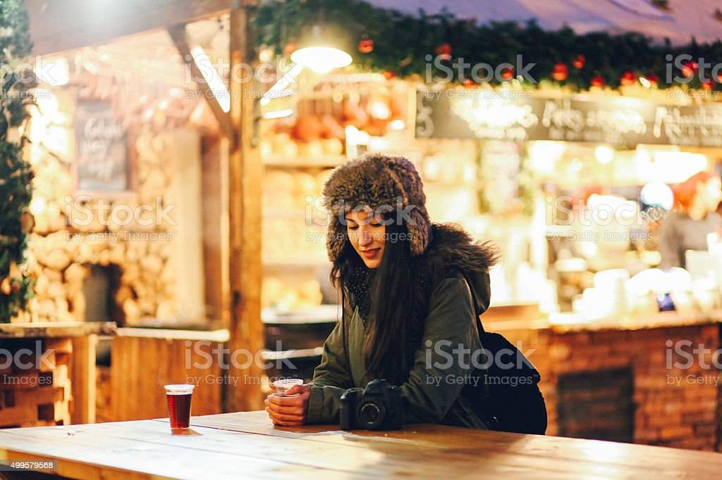 Winter portrait of a smiling young woman in town stock photo
