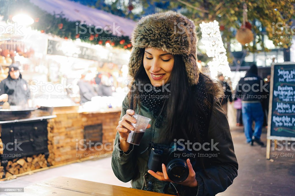 Winter portrait of a smiling young woman photographer stock photo
