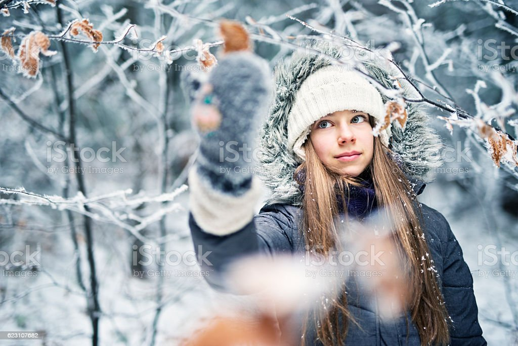 Winter portrait of a teenage girl stock photo