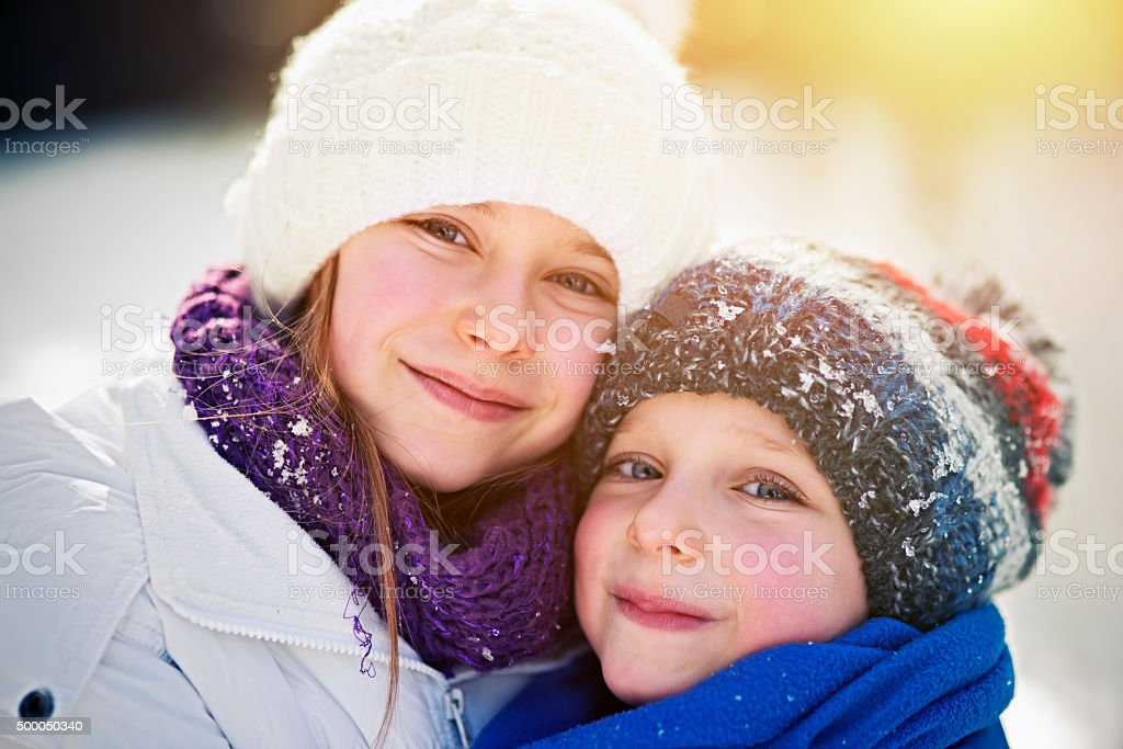 Winter portrait of brother and sister stock photo
