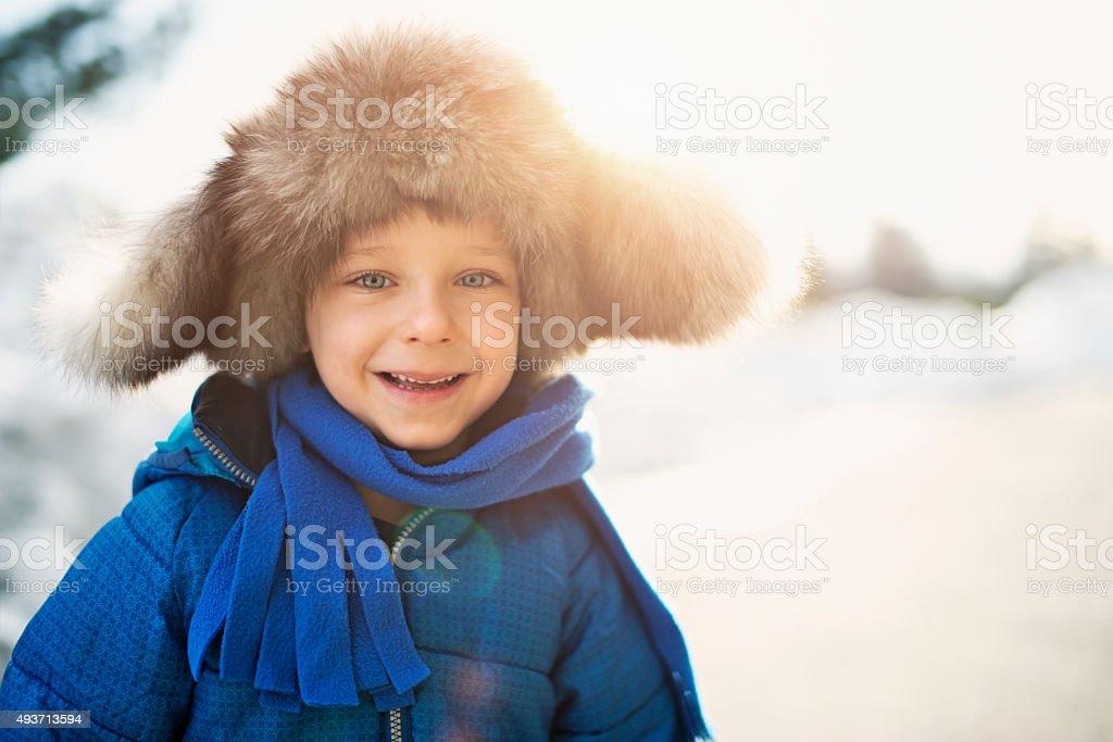 Winter portrait of funny little boy stock photo