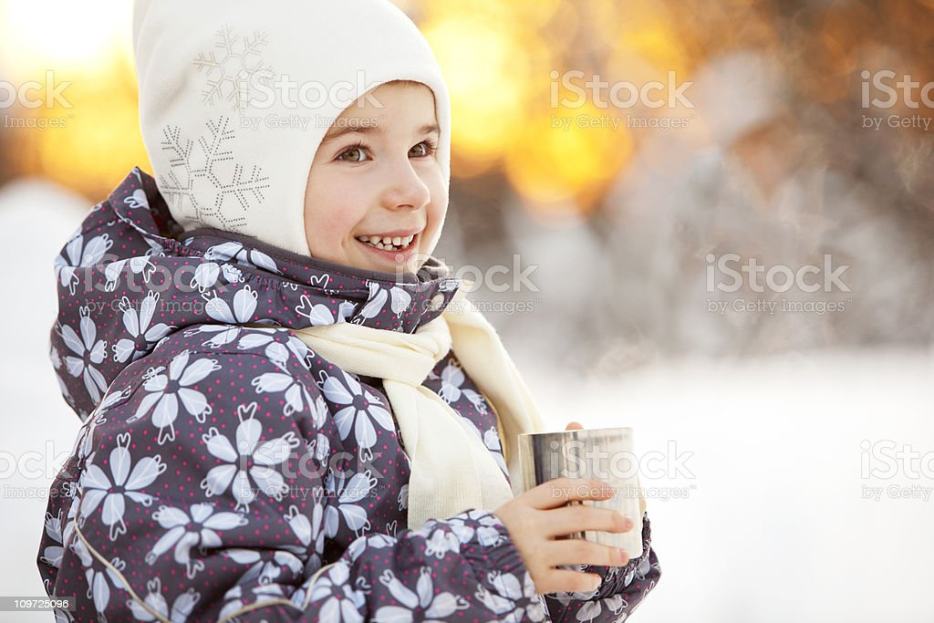 Winter Portrait of Laughing Little Girl Drinking Tea Outdoors royalty-free stock photo