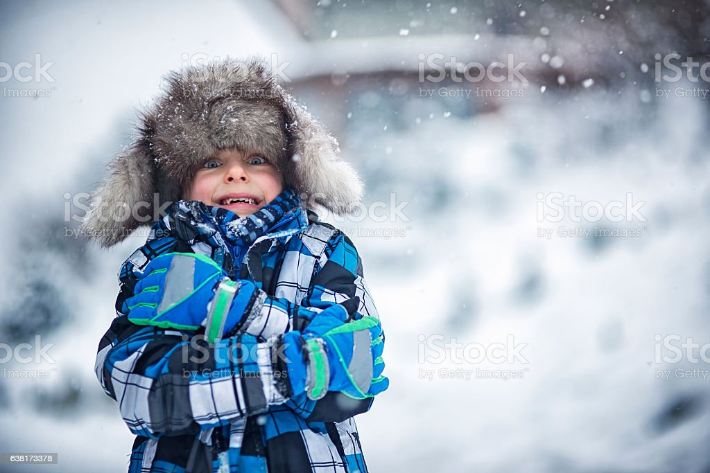 Winter portrait of little boy on a freezing day stock photo