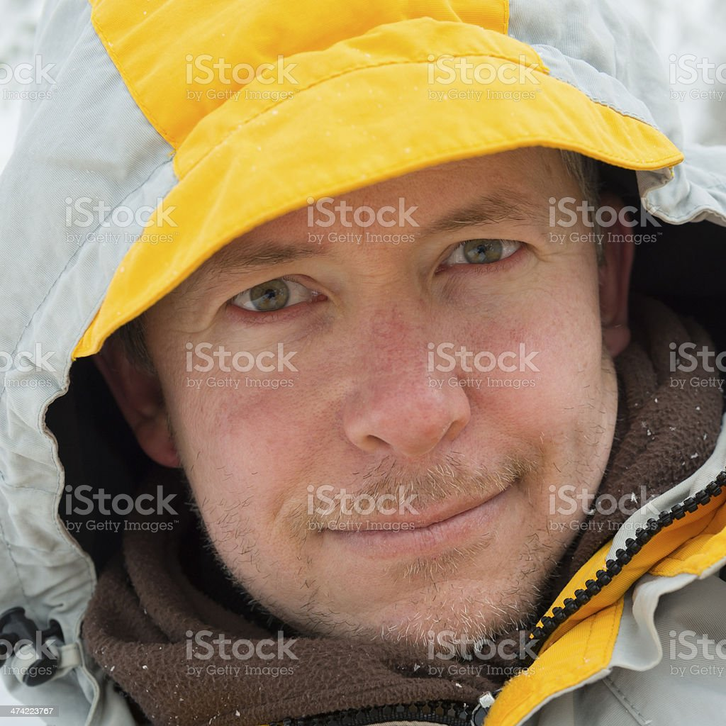 Winter portrait of man in winter coat and scarf stock photo
