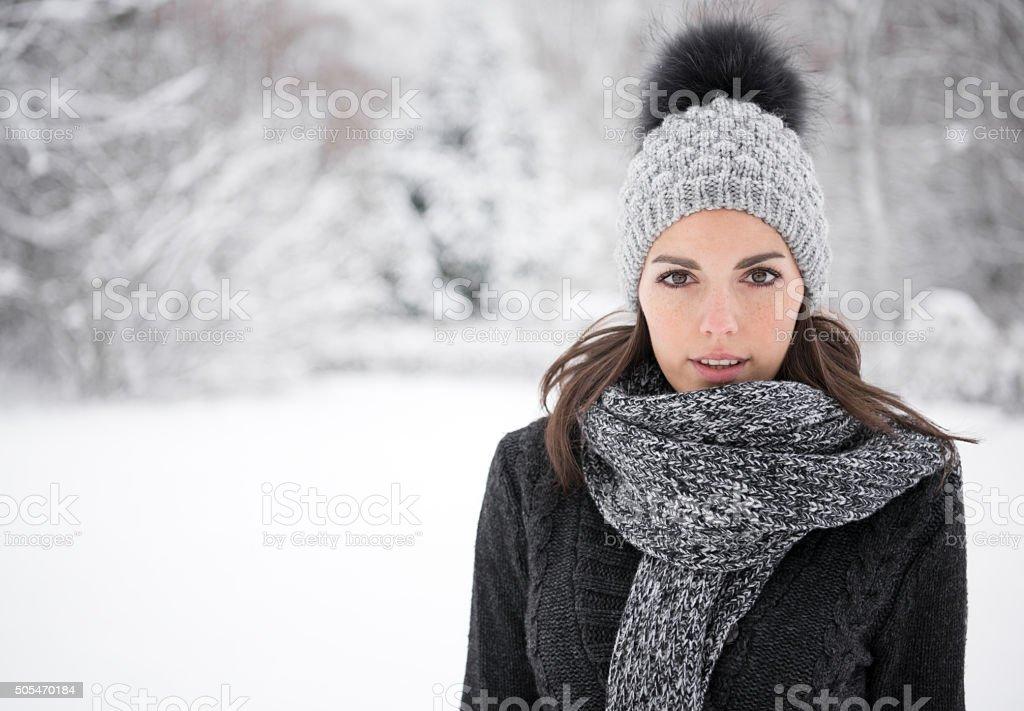 Winter Portrait, Woman enjoying this snowy Winter Day stock photo