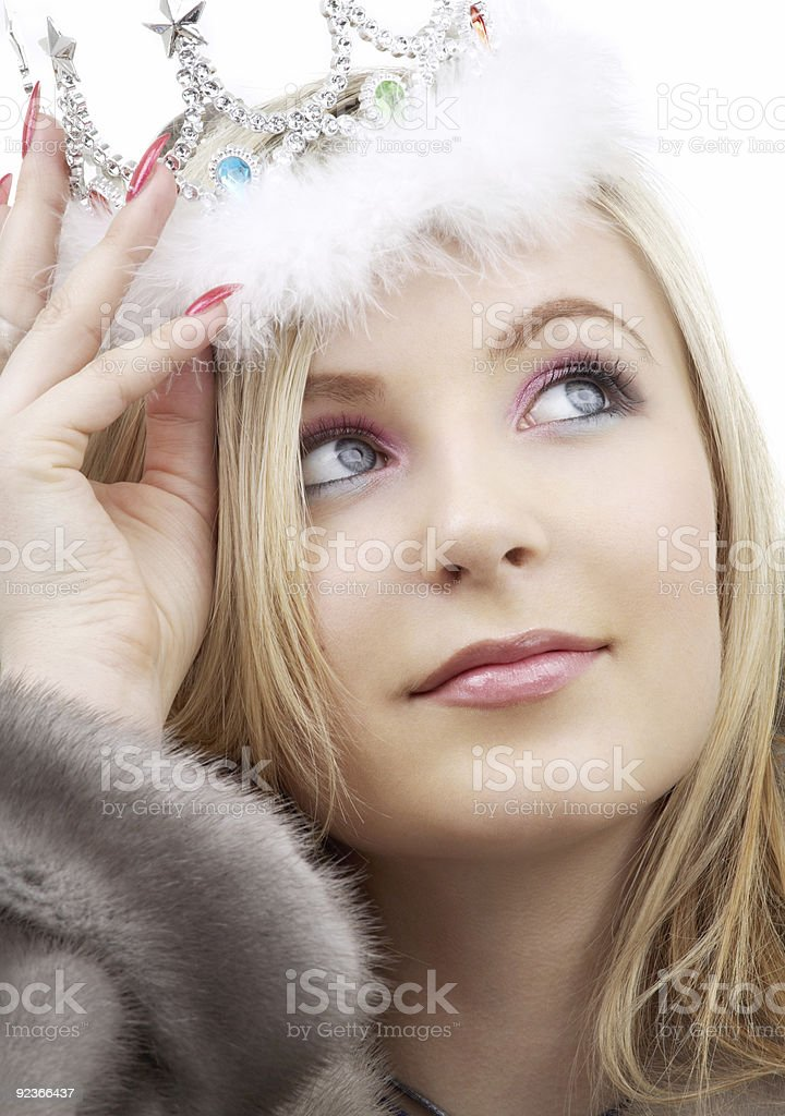 A winter queen in a fur coat looking at the sky royalty-free stock photo