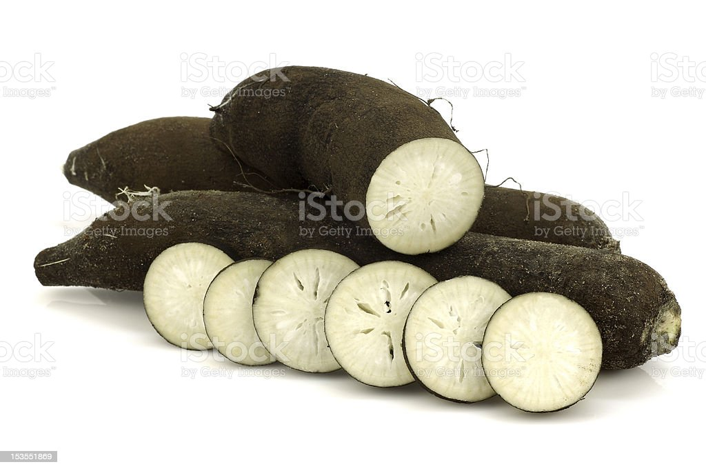 winter radishes (Raphanus sativus subsp. niger) and a cut one royalty-free stock photo