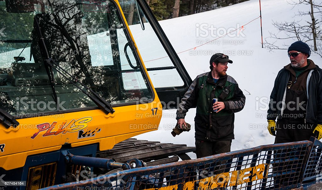 Winter repair crew working on SnowCat Ski Resort stock photo
