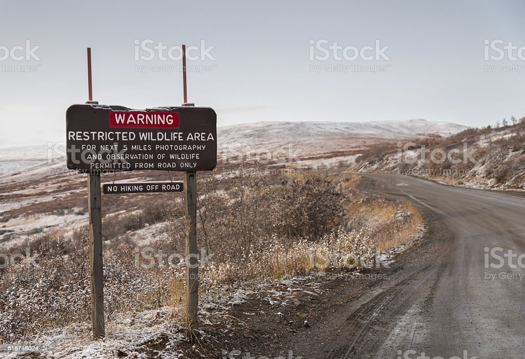 Winter Restricted Wildlife Area Warning Sign With Dirt Road stock photo