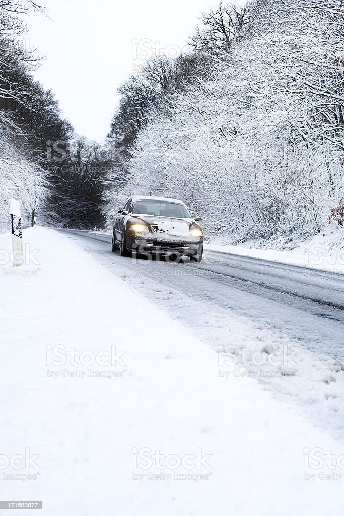 Winter road conditions, approaching car royalty-free stock photo