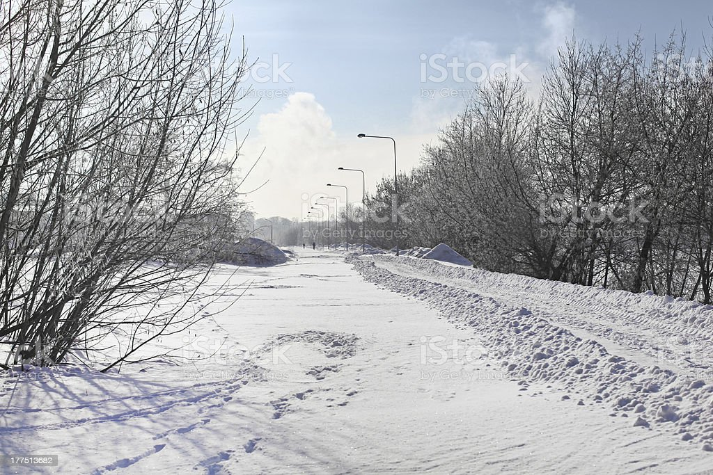 Winter road in capital of Latvia with big snowbanks stock photo