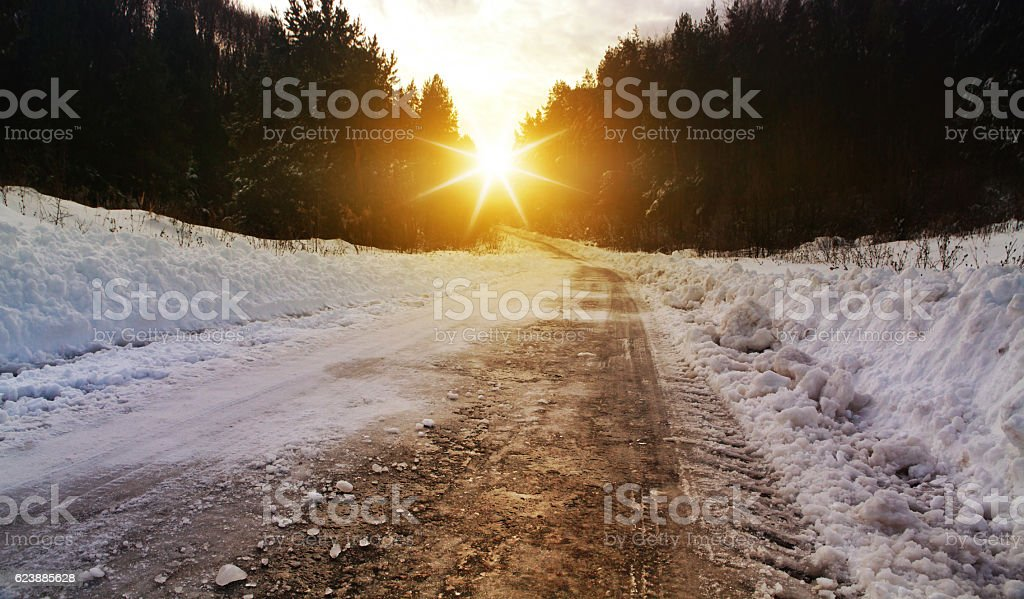 winter road in rural areas at sunset stock photo