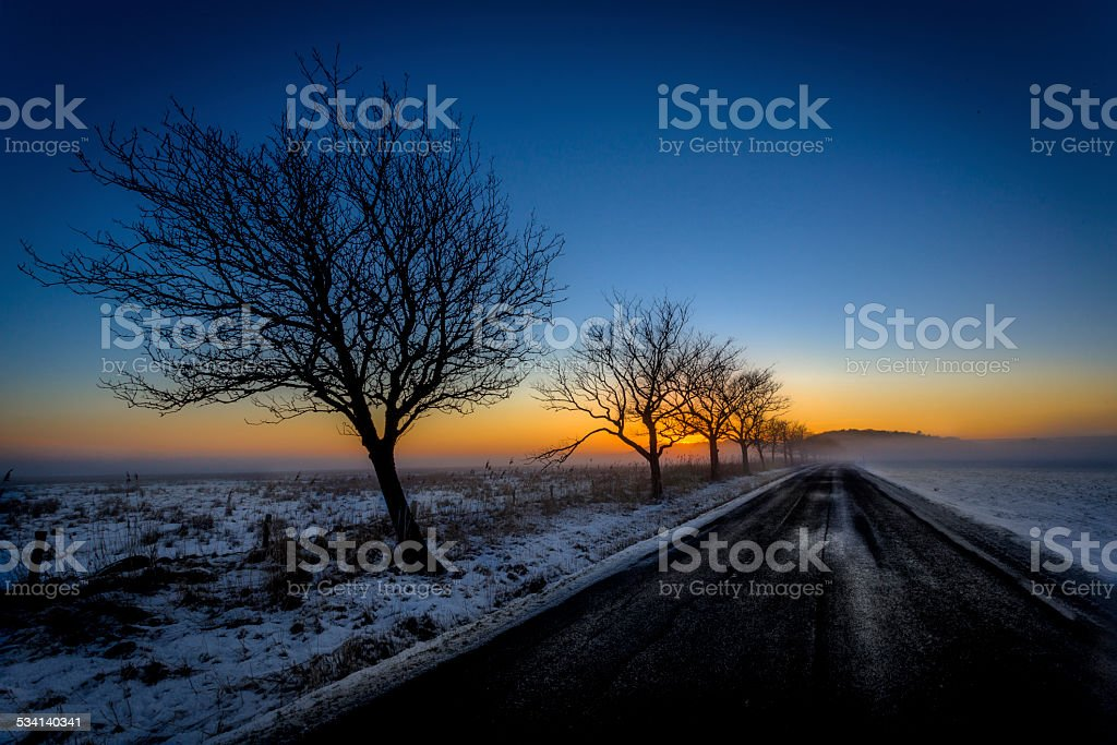 Winter road in sunset stock photo