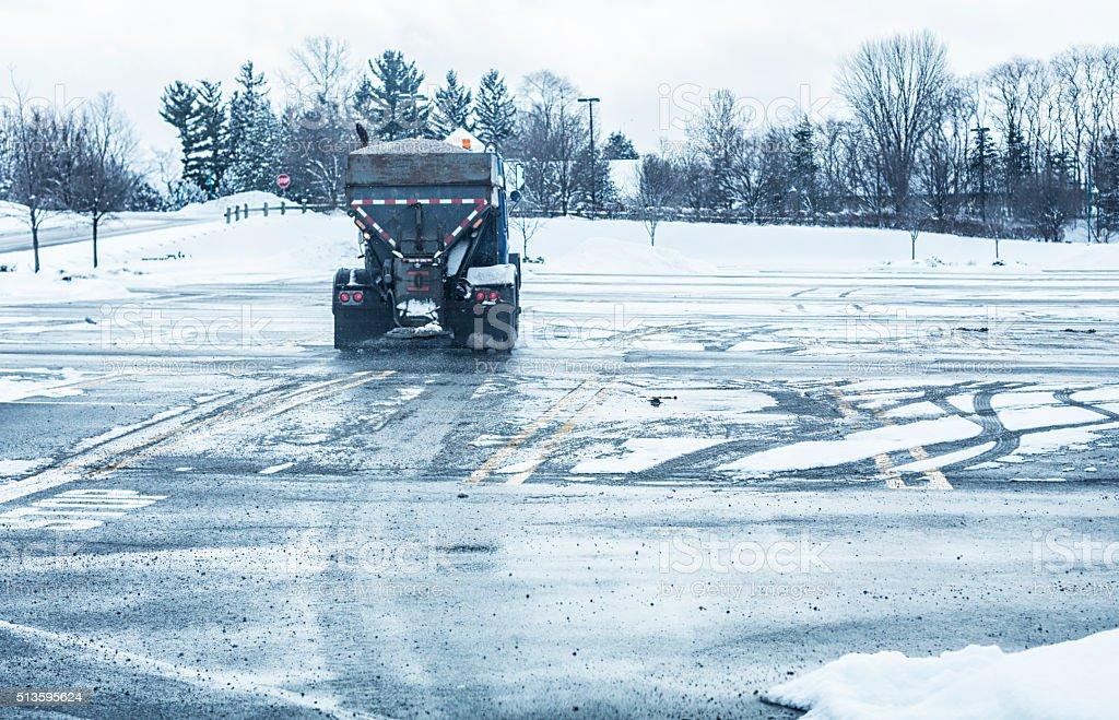 Winter Road Rock Salt Spreader Dump Truck Salting Parking Lot stock photo