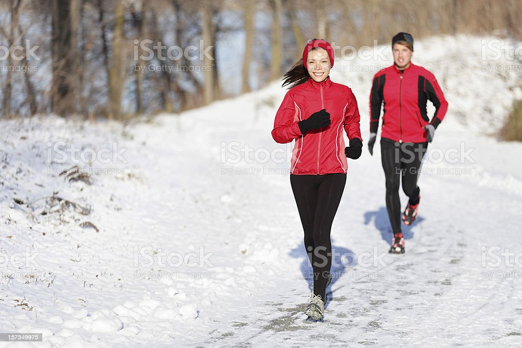 Winter running exercise couple stock photo