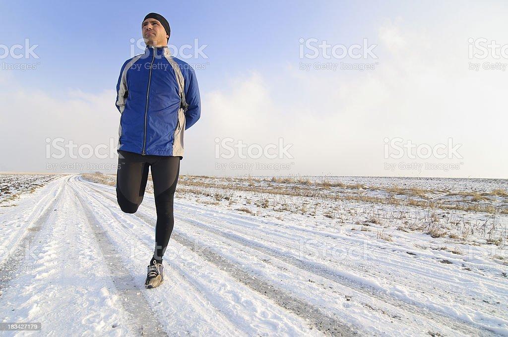 Winter Running - Stretching royalty-free stock photo