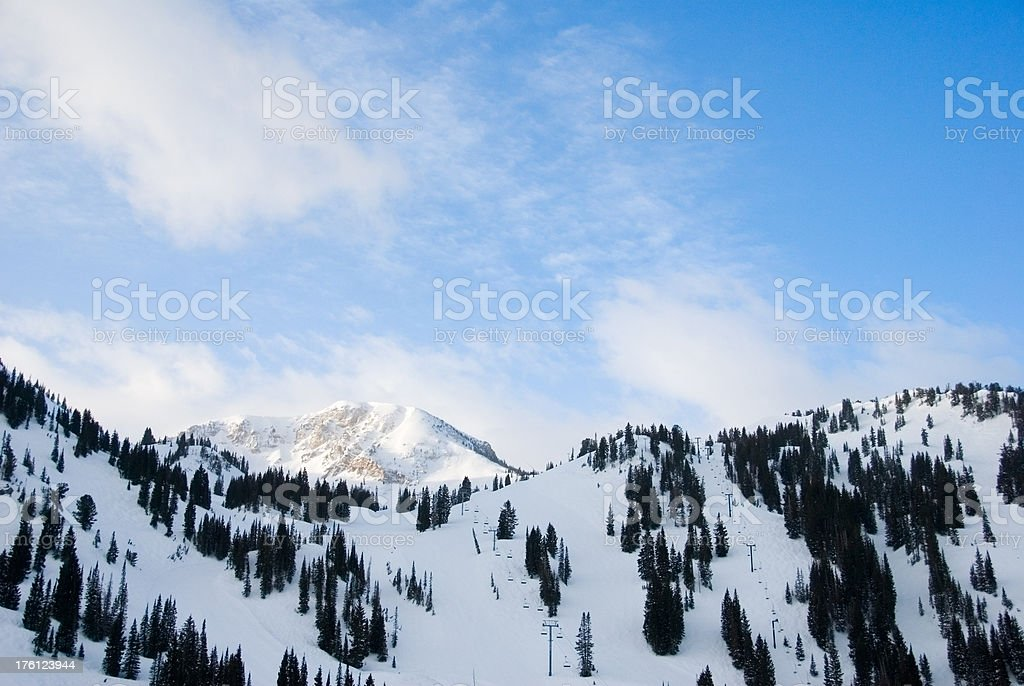 Winter scene at the ski resort - snow covered mountains stock photo