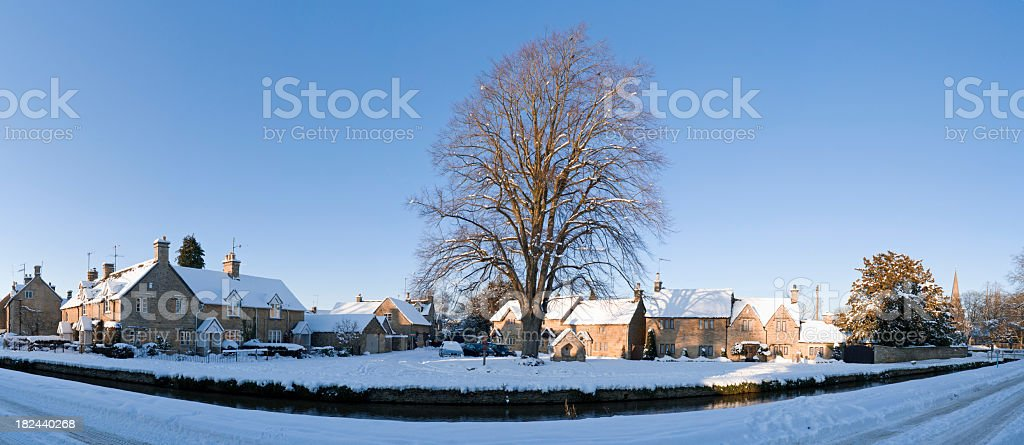 Winter scene idyllic Cotswold village in the snow royalty-free stock photo