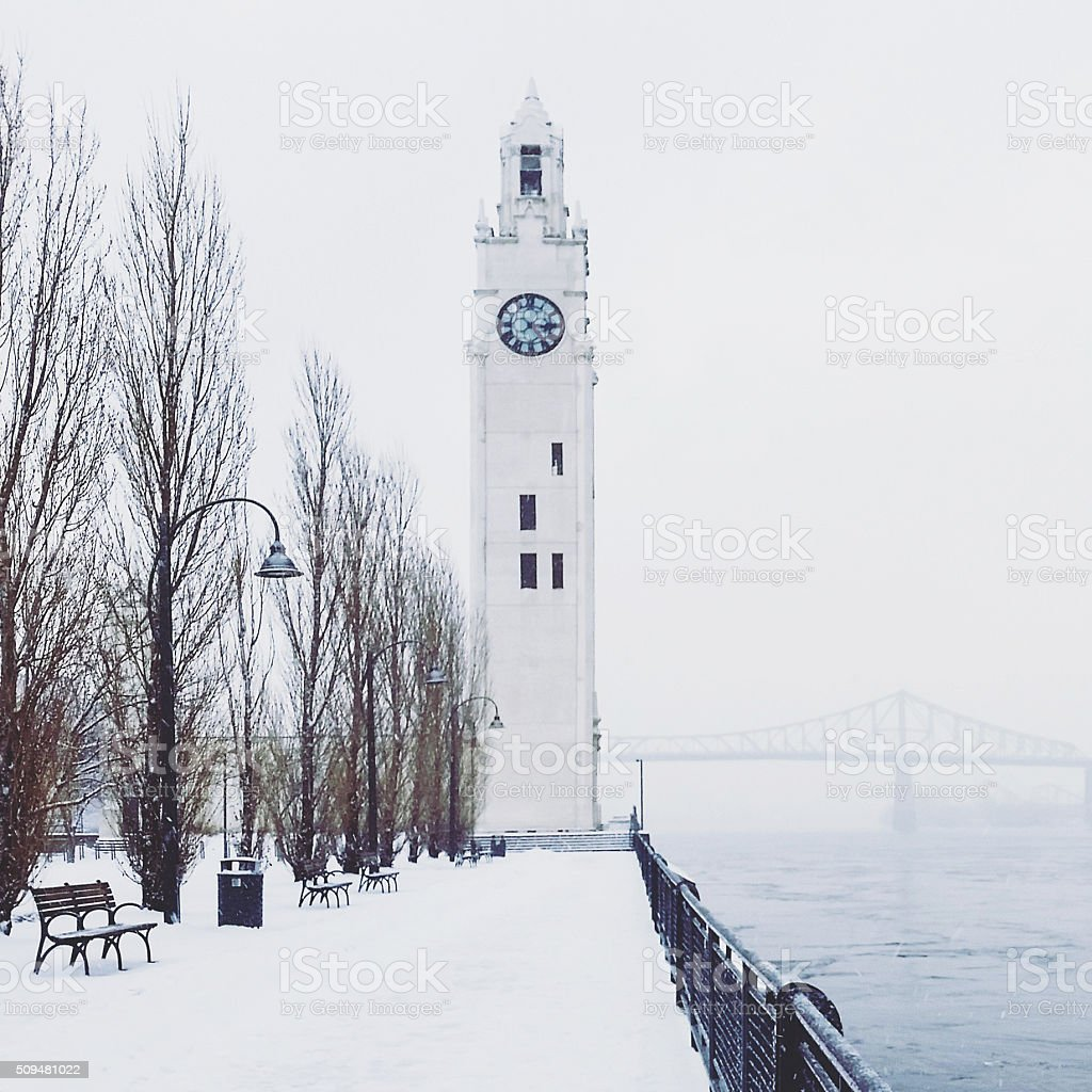 Winter Scene Montreal Clock Tower Architecture by Pont Jacques Cartier stock photo