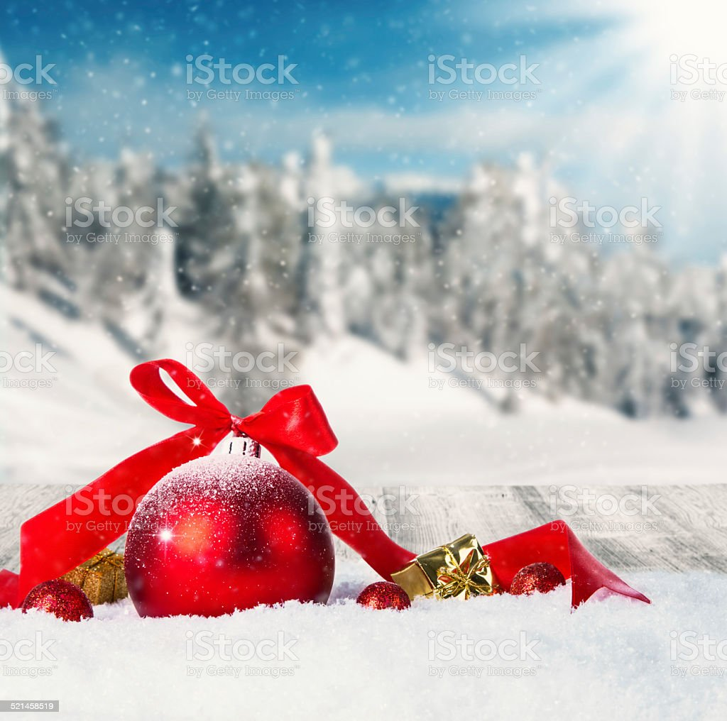 Winter scenery with christmas ball stock photo