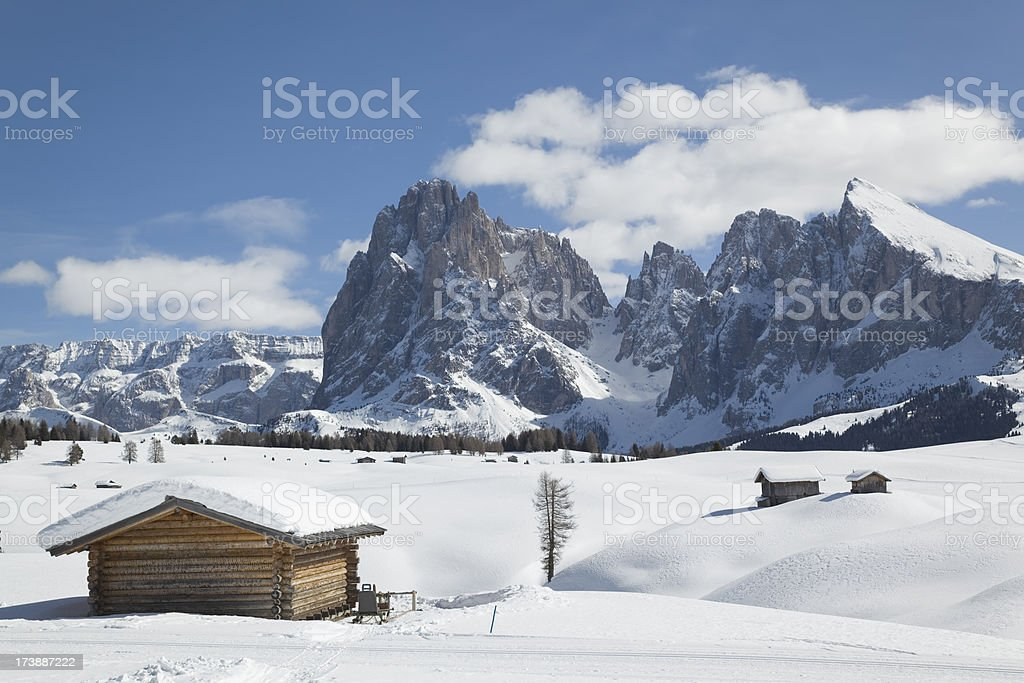 Winter scenics with shack and Langkofel mountain in Dolomites, Italy stock photo