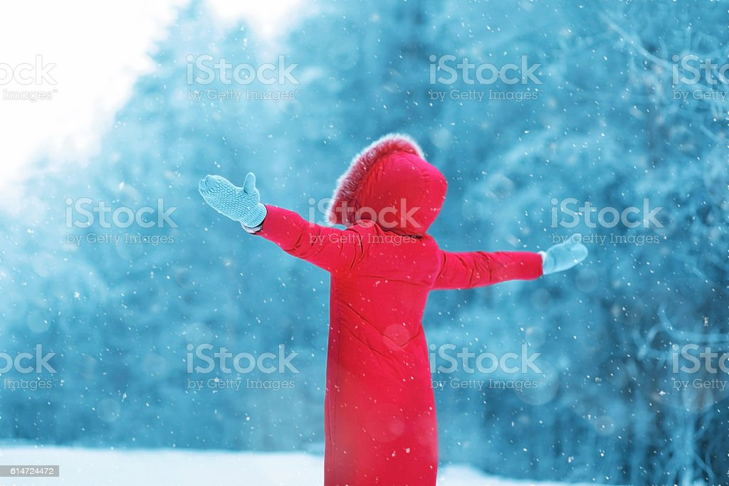 Winter season is open! Abstract silhouette of woman enjoys winter stock photo