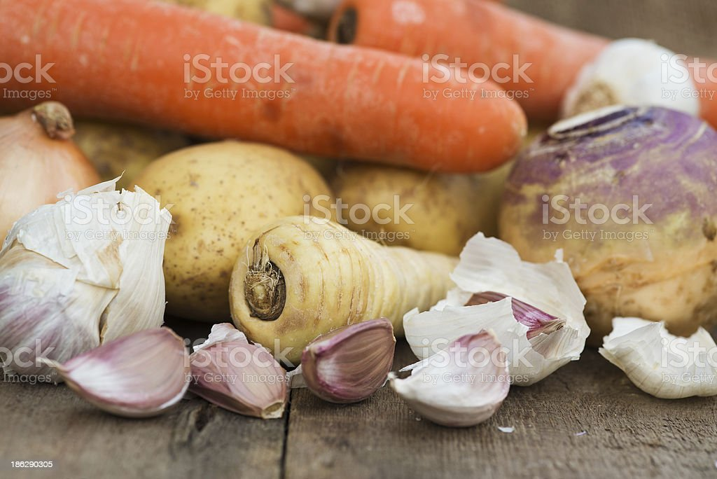 Winter seasonal vegetables collection including potatoes parsnips swede and carrots stock photo