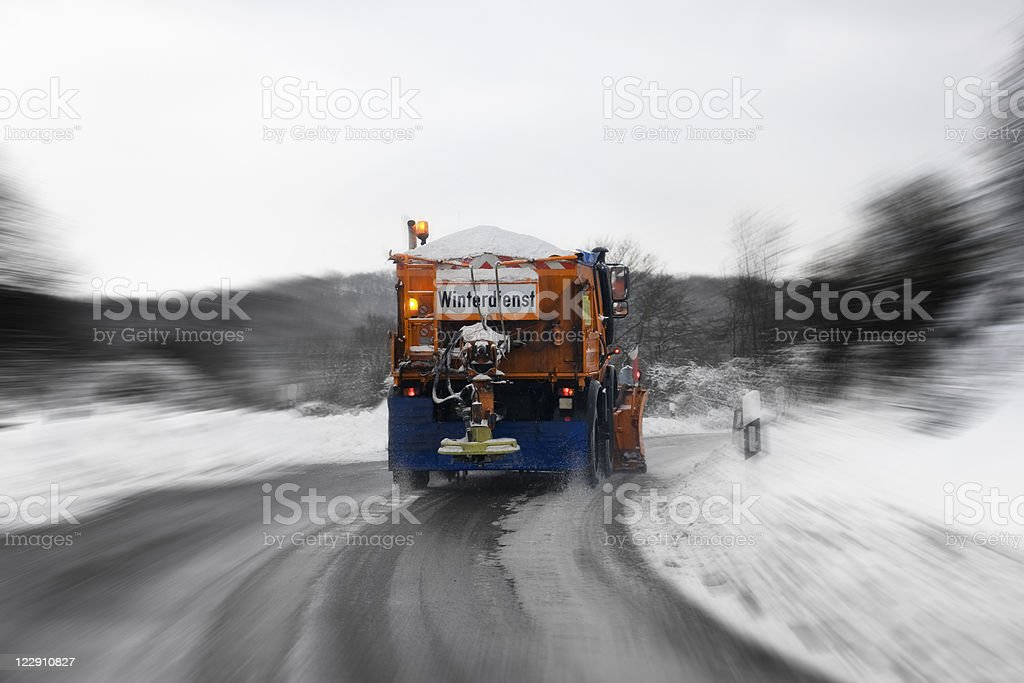 Winter service in action - bad road conditions royalty-free stock photo