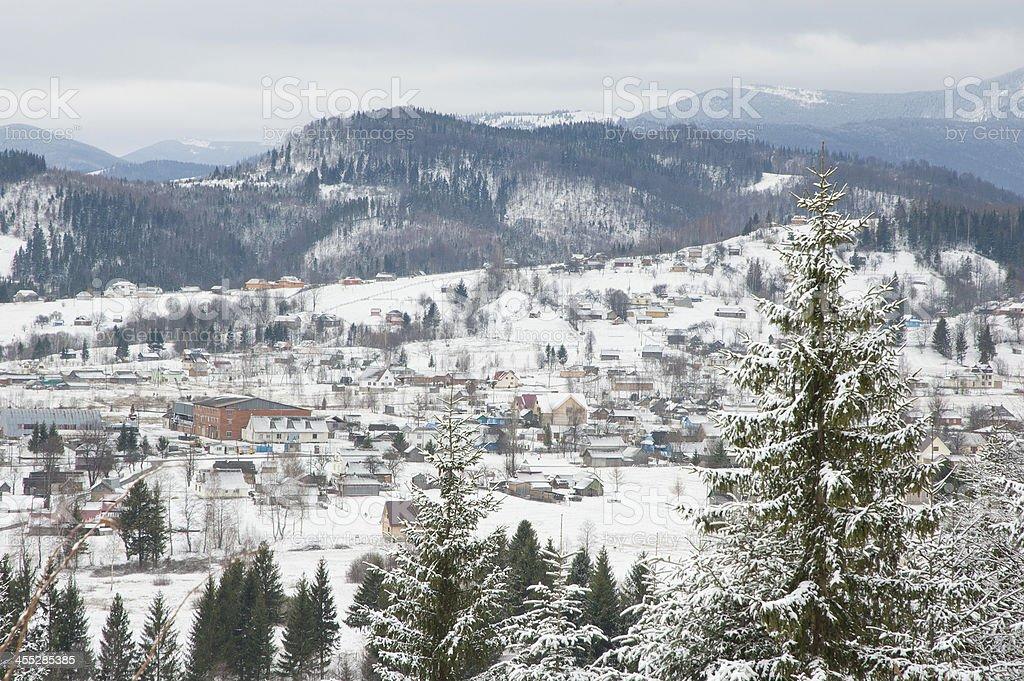 Winter settlement in Carpathian Mountains. stock photo
