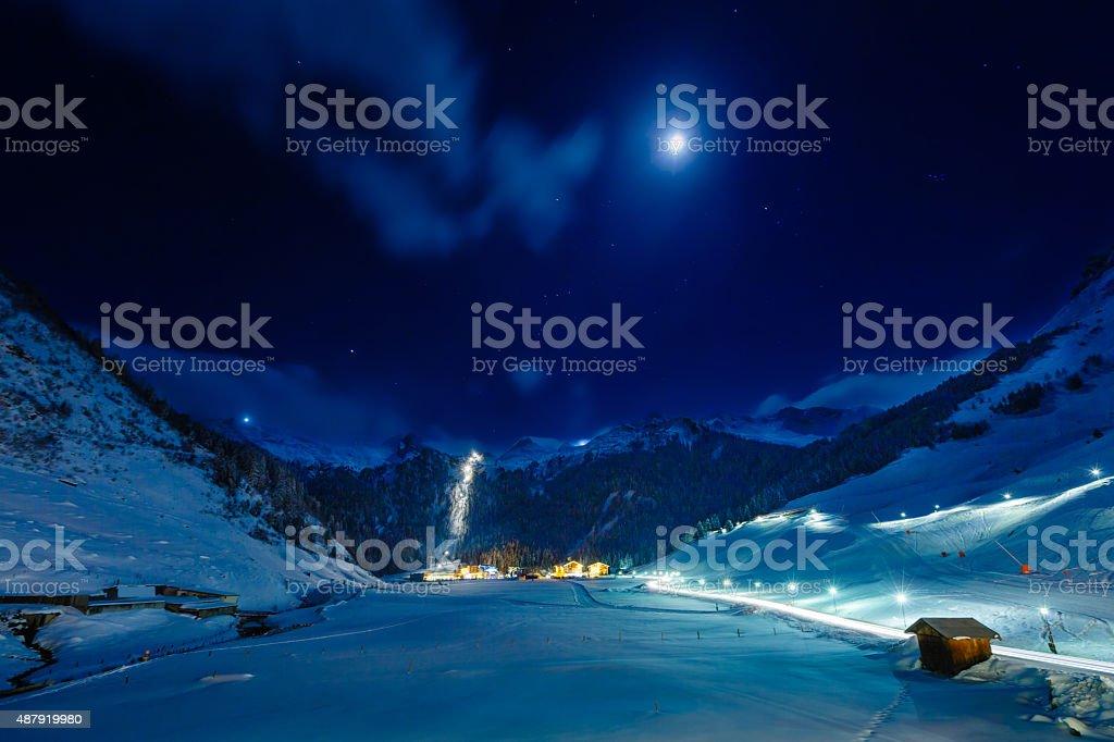 Winter ski resort Hintertux by night, Tirol, Austria stock photo