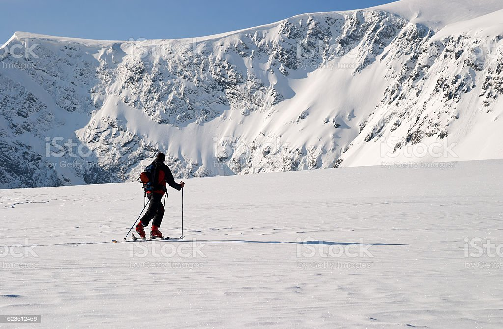 Winter ski touring in the heart of the mountain stock photo
