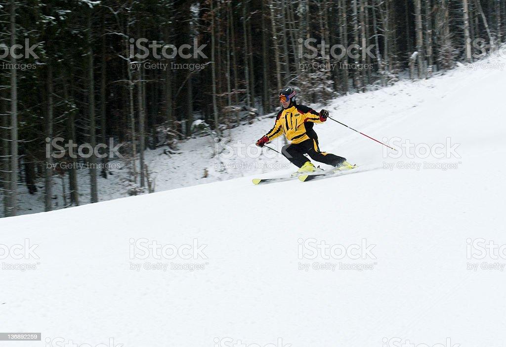 Professional skier go down along black route. Bukovel, ukrainian ski...