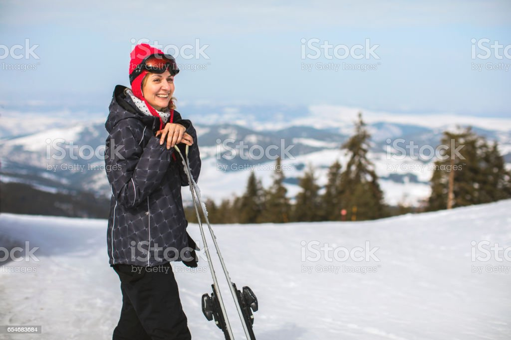 Women stading on skis on a top of the hill,winter,sport concept