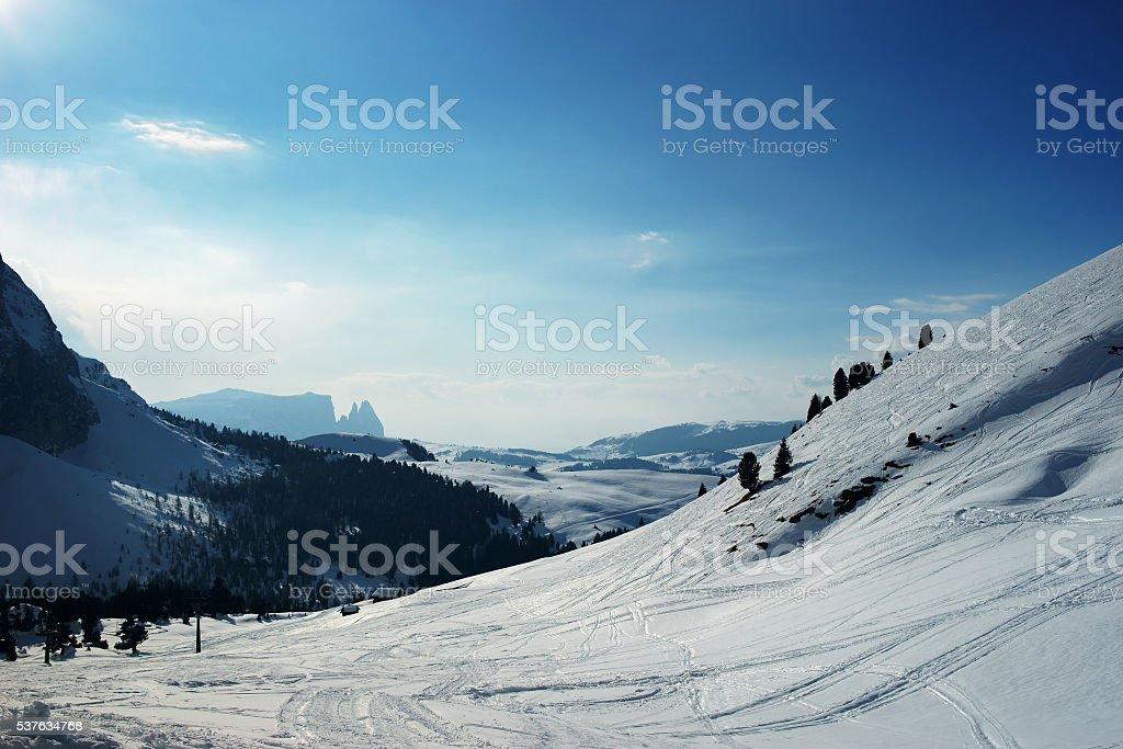 Snowy winter mountains. View on skiing slopes at ski resort at Alps...